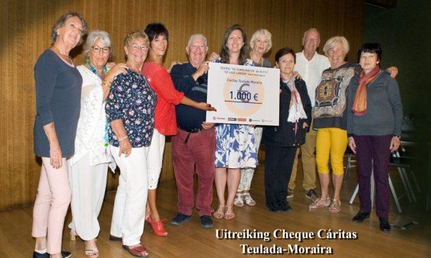 Uitreiking cheque aan Caritas